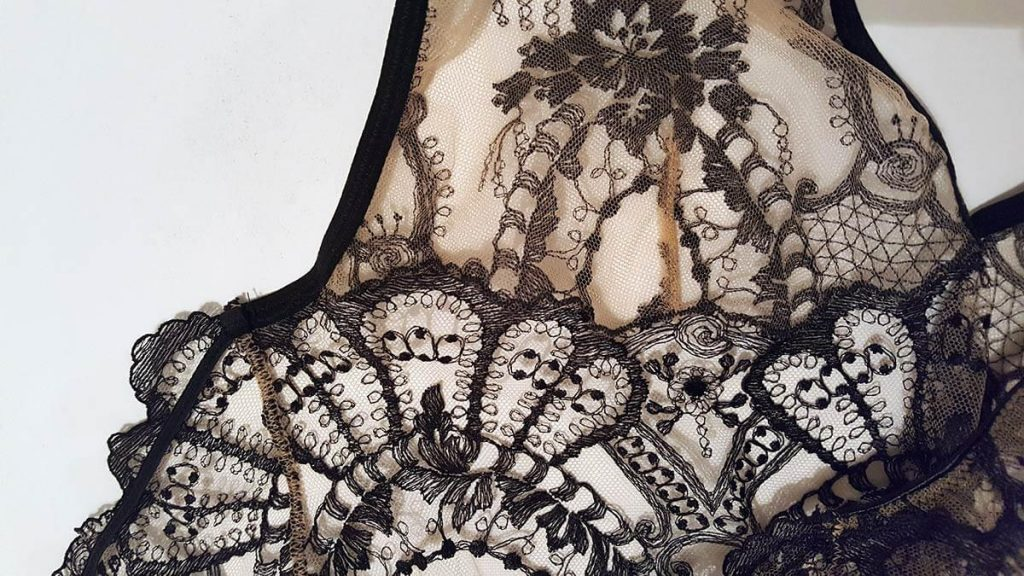 Embroidery detail of the 'La Naissance De Venus' slip